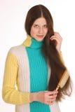 Flickan att bry sig för härligt hår Royaltyfri Foto
