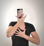 Flickan blir Smartphone på vit Royaltyfria Bilder