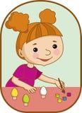 Flickan förbereder sig för påsk Royaltyfria Bilder