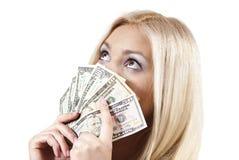 flickan håller pengar Royaltyfria Bilder