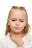 Flickan har en öm hals Fotografering för Bildbyråer