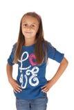 Flickan i blått med hennes händer på hennes höfter i slösar överkanten Arkivbilder