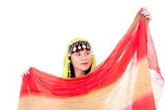 Flickan i den östliga klänningen som dansar Fotografering för Bildbyråer