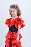 Flickan i en röd spanjorklänning Royaltyfria Bilder