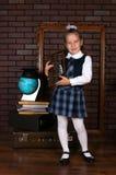Flickan i en skolalikformig Royaltyfri Fotografi