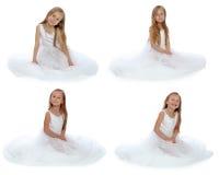 Flickan i en vit bollklänning Arkivfoto