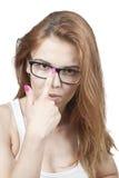 Flickan i exponeringsglas. Arkivbild