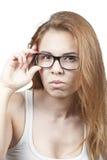 Flickan i exponeringsglas. Royaltyfri Foto