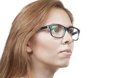 Flickan i exponeringsglas. Arkivfoto