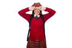 Flickan i skotska tartankläder som isoleras på vit Royaltyfria Foton