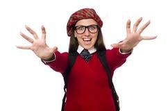Flickan i skotska tartankläder som isoleras på vit Royaltyfri Foto