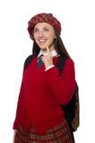 Flickan i skotska tartankläder som isoleras på vit Arkivfoto