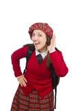 Flickan i skotska tartankläder som isoleras på vit Arkivbild
