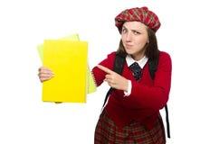 Flickan i skotska tartankläder som isoleras på vit Fotografering för Bildbyråer