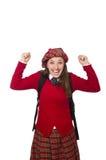 Flickan i skotska tartankläder som isoleras på vit Royaltyfri Bild