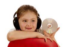 flickan ii lyssnar musik till Royaltyfri Bild