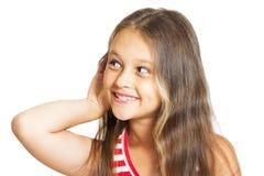 flickan lyssnar Fotografering för Bildbyråer