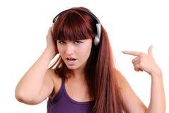 flickan lyssnar musik till Royaltyfri Fotografi