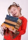Flickan med böcker Fotografering för Bildbyråer
