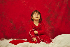 Flickan med den röda och vita raden för MărÈ› iÈ™or Arkivbild