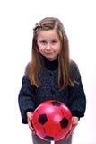 Flickan med en boll Royaltyfri Foto