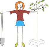 Flickan med en skyffel planterar trädet Jorddag, vår, nedgång som arbeta i trädgården, skydd av naturen Royaltyfria Foton