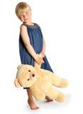 Flickan med en stor nallebjörn Arkivbilder