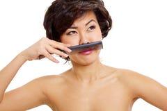 Flickan med fejkar mustaschen arkivbilder