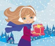 Flickan med gåvan boxas Royaltyfria Foton
