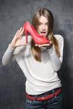 Flickan med rött skor Fotografering för Bildbyråer