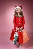 Flickan med shopping hänger lös Arkivfoto