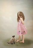 Flickan och katten Arkivfoto