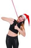 Flickan på en ` s för nytt år bantar Flicka med att mäta bandet runt om hennes hals Stolpe-ferie bantar Royaltyfri Fotografi