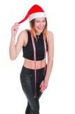 Flickan på en ` s för nytt år bantar Flicka med att mäta bandet runt om hennes hals Stolpe-ferie bantar Arkivfoto