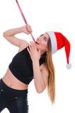 Flickan på en ` s för nytt år bantar Flicka med att mäta bandet runt om hennes hals Stolpe-ferie bantar Royaltyfri Bild