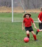 Flickan på fotboll sätter in 16 royaltyfri fotografi