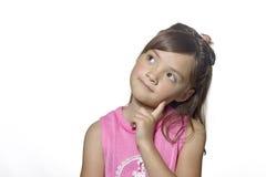 flickan poserar fundersamt barn royaltyfria foton