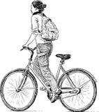 Flickan rider en cykel royaltyfri illustrationer