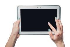 Flickan rymmer en platta på en vit bakgrund, ramen för foto arkivbild