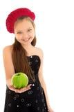Flickan rymmer ut en Apple Royaltyfria Foton