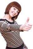 flickan som ger skratta skjorta t, tumm upp Royaltyfri Bild