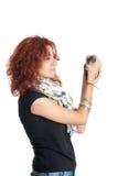 Flickan som rymmer ett svart, tjaller Arkivfoto