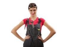Flickan står med en skiftnyckel Fotografering för Bildbyråer