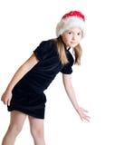Flickan tonåringen i Jultomte hatt Arkivbilder