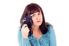 Flickan tröttades av videospel Arkivbild