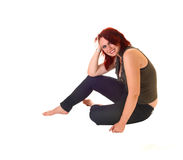 Flickasammanträde på golv. Royaltyfri Fotografi