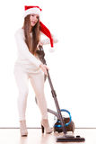 FlickaSanta Claus hatt med dammsugare Royaltyfria Foton