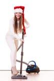 FlickaSanta Claus hatt med dammsugare Arkivfoton