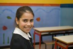 Flickastudent i skolalikformig Royaltyfria Foton