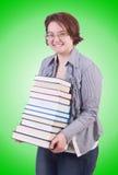 Flickastudent med böcker på vit Royaltyfri Foto